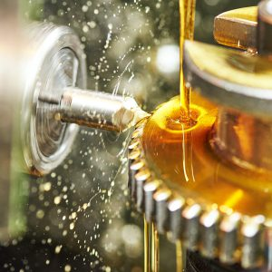 A metalworking fluid is used to maintain a protective film between the die or tool and the metal billet (a length of metal with a round or square cross section, created by continuous casting or extrusion). Such a film acts to reduce the frictional heat generated during the operation. The lubricant is expected to prolong the life of the die or tool, reduce energy requirements, and produce a smooth, stain-free surface of the metal article. In certain nonferrous metalworking applications, KEMAT polybutenes have several advantages over mineral oils when used as a lubricant.
